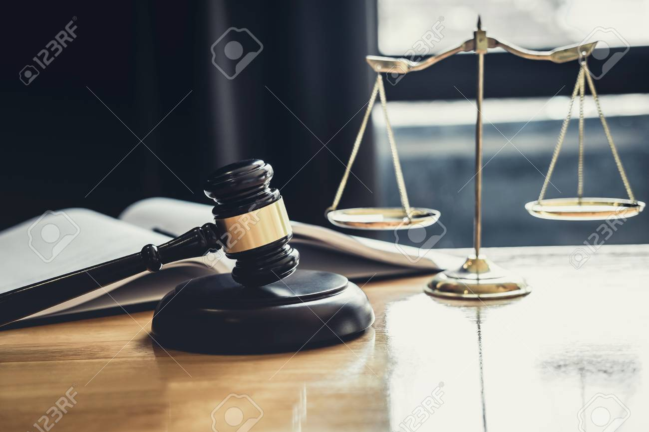 Judge gavel with Scale of justice, object documents working on table in courtroom, Legal law advice and justice concept. - 119796992