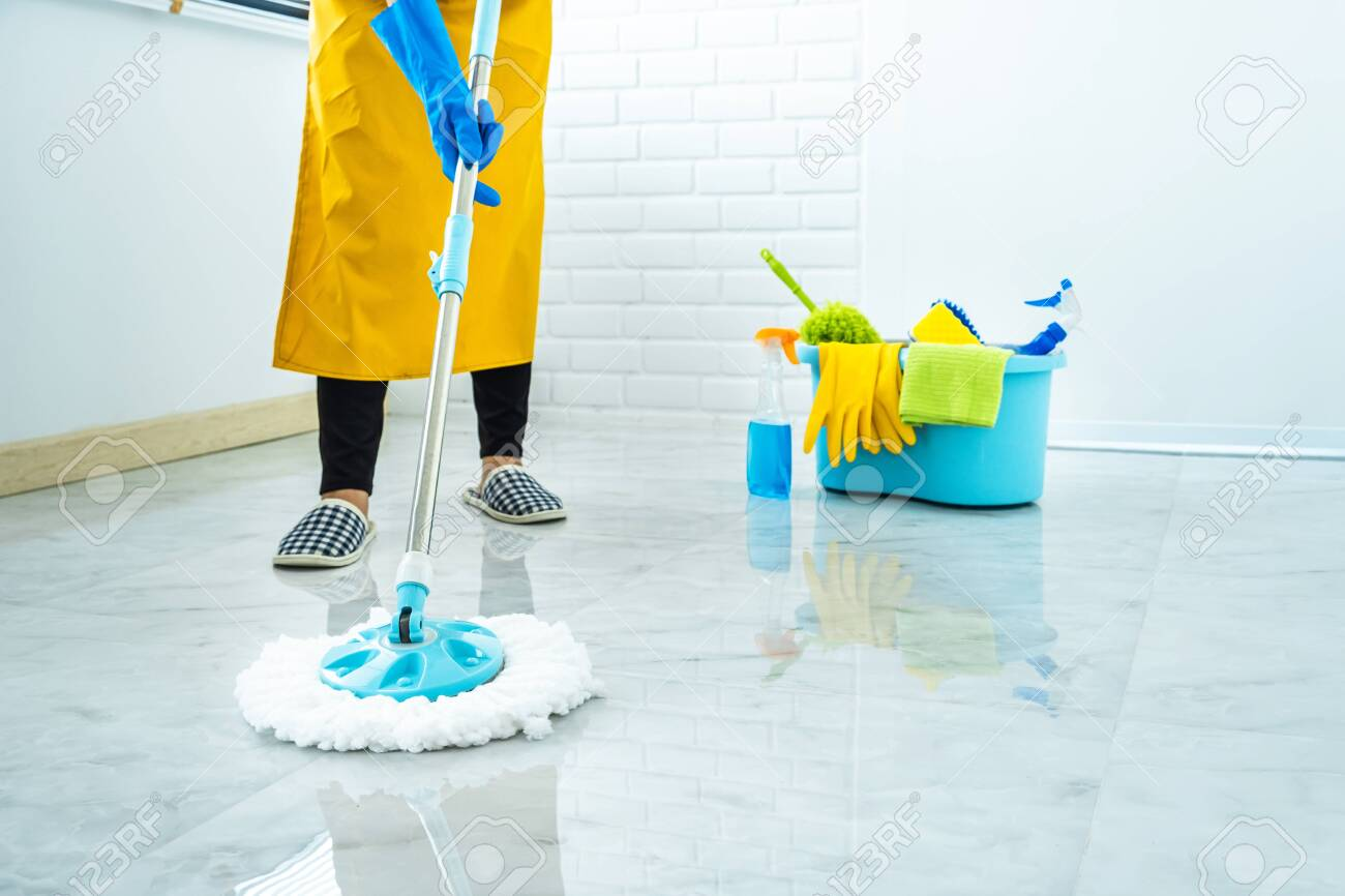 Wife housekeeping and cleaning concept, Happy young woman in blue rubber gloves wiping dust using mop while cleaning on floor at home. - 143216110