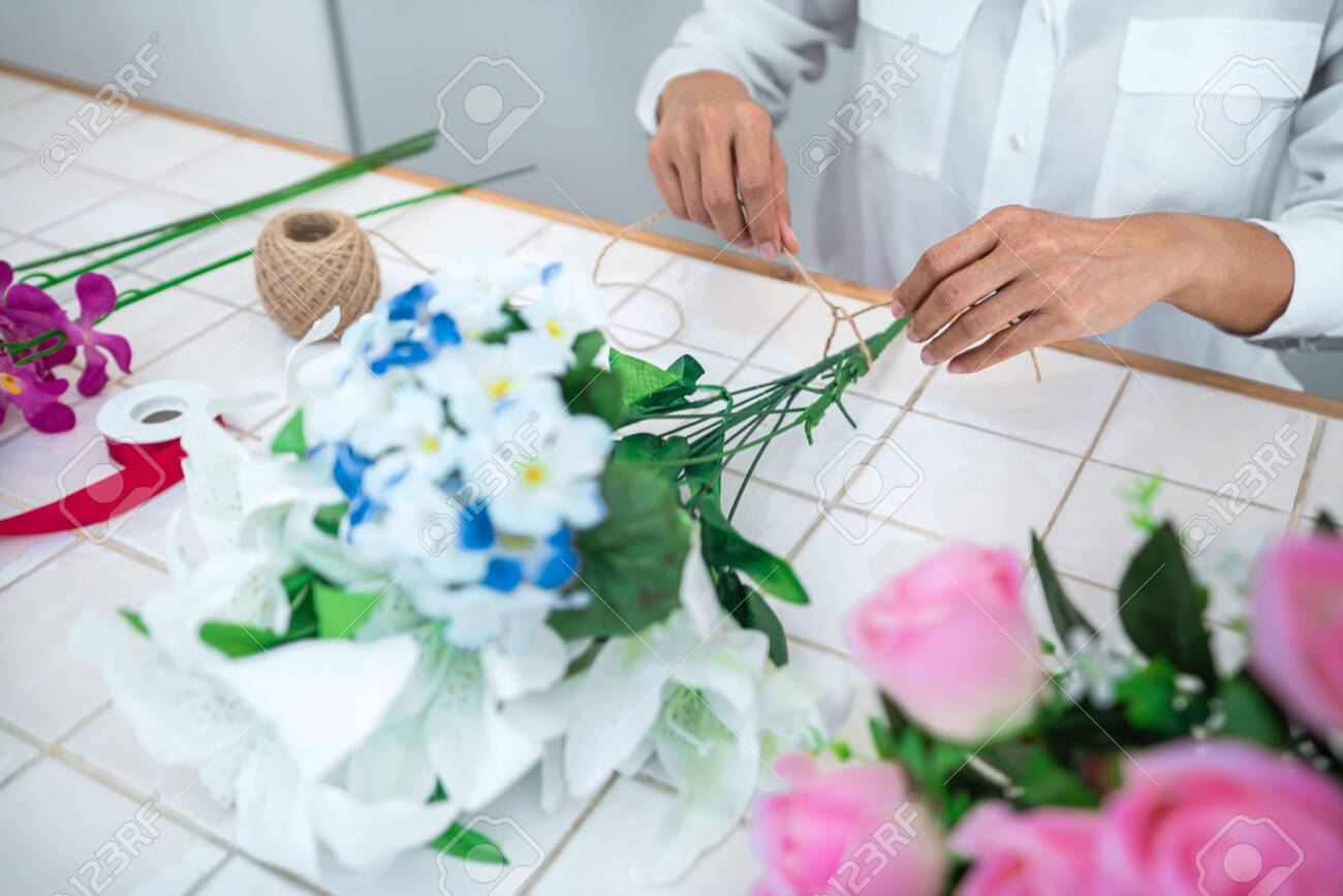 Arranging Artificial Flowers Decoration At Home Young Woman Stock Photo Picture And Royalty Free Image Image 147259873
