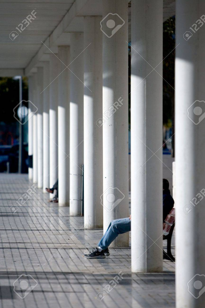 Wondrous Rows Of White Pillars And Modern Architecture With People Sitting Alphanode Cool Chair Designs And Ideas Alphanodeonline