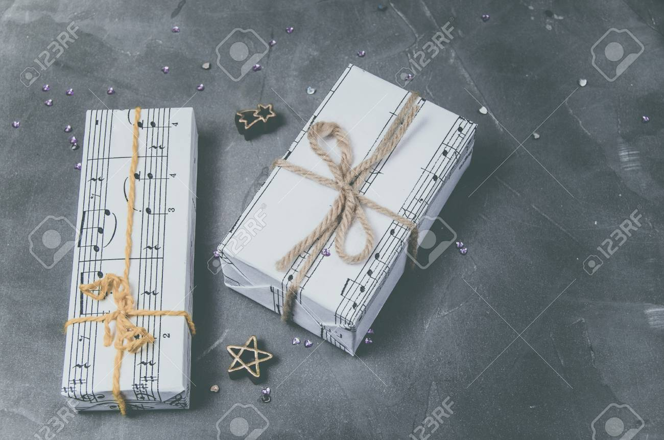 Gifts Wrapped In Paper With The Image Of Music. Christmas Holiday ... 4f1a5a82b9
