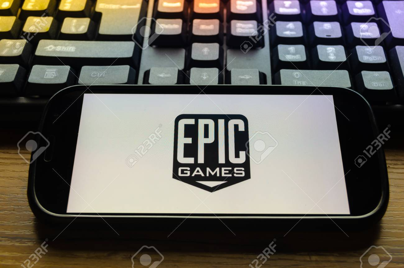 Mobile phone on the background of the keyboard, with the screen