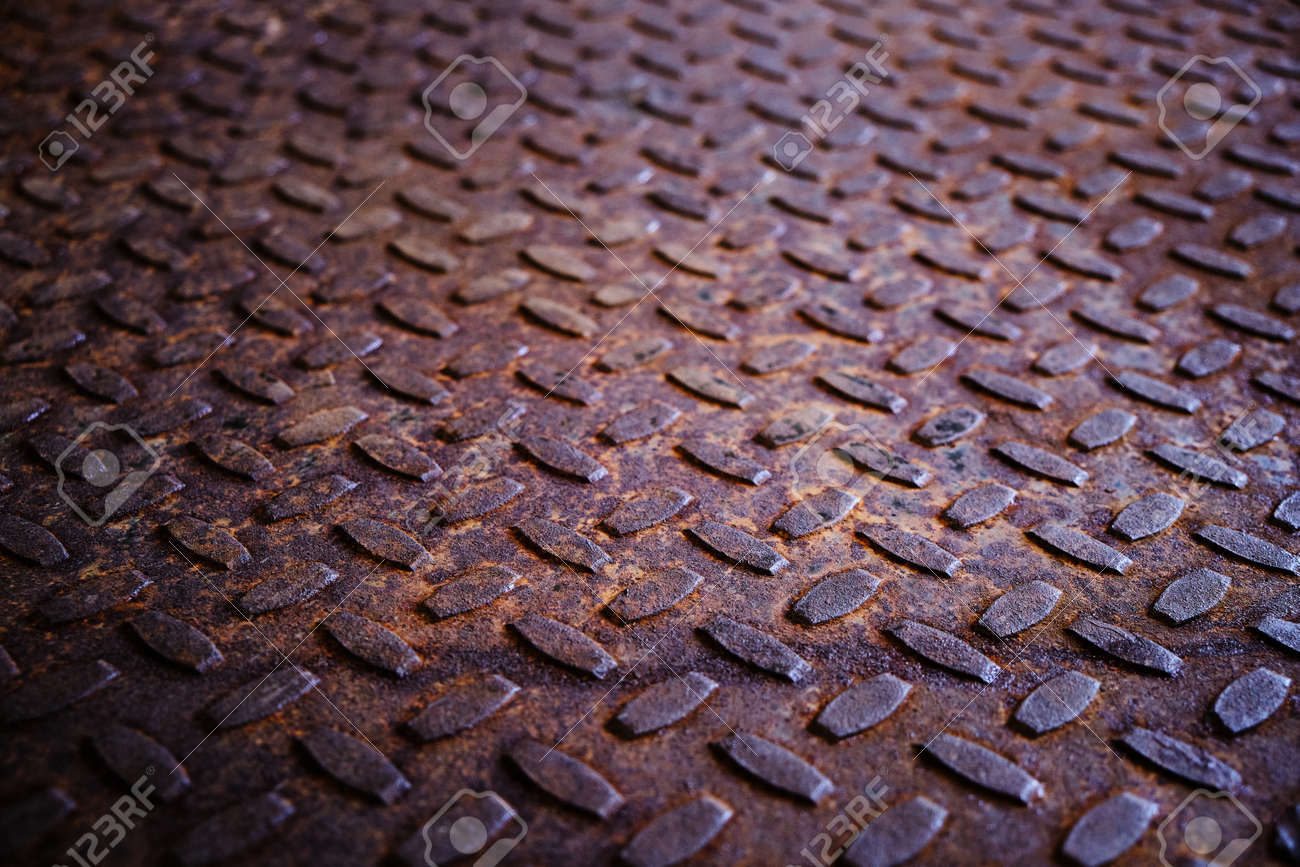 Old and rusty metal floor. Texture of a rough metal sheet with a convex pattern - 148600669