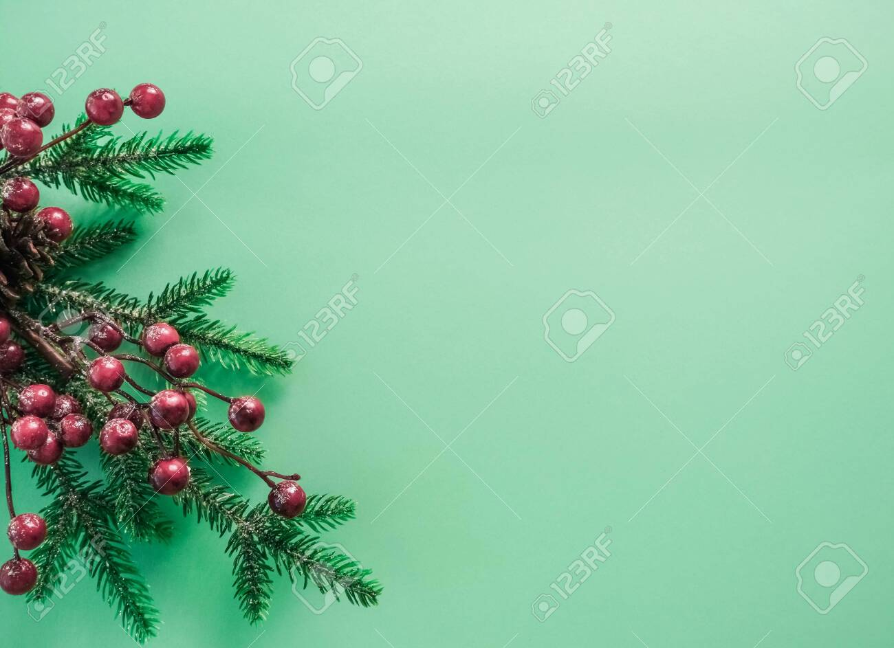 Christmas Decorations With Red Berries And Fir Branches On A Stock Photo Picture And Royalty Free Image Image 132292007