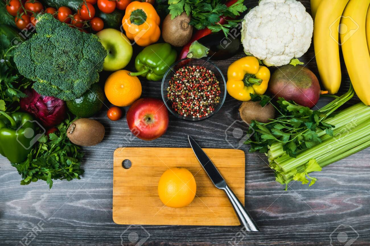 Harvest Festival, Thanksgiving. Diet for weight loss. A balanced healthy diet. Useful recipes. Eco-, bio-products. Cooking smoothies. On a cutting board is knife and orange. Flatlay, layout, view top. - 144037550