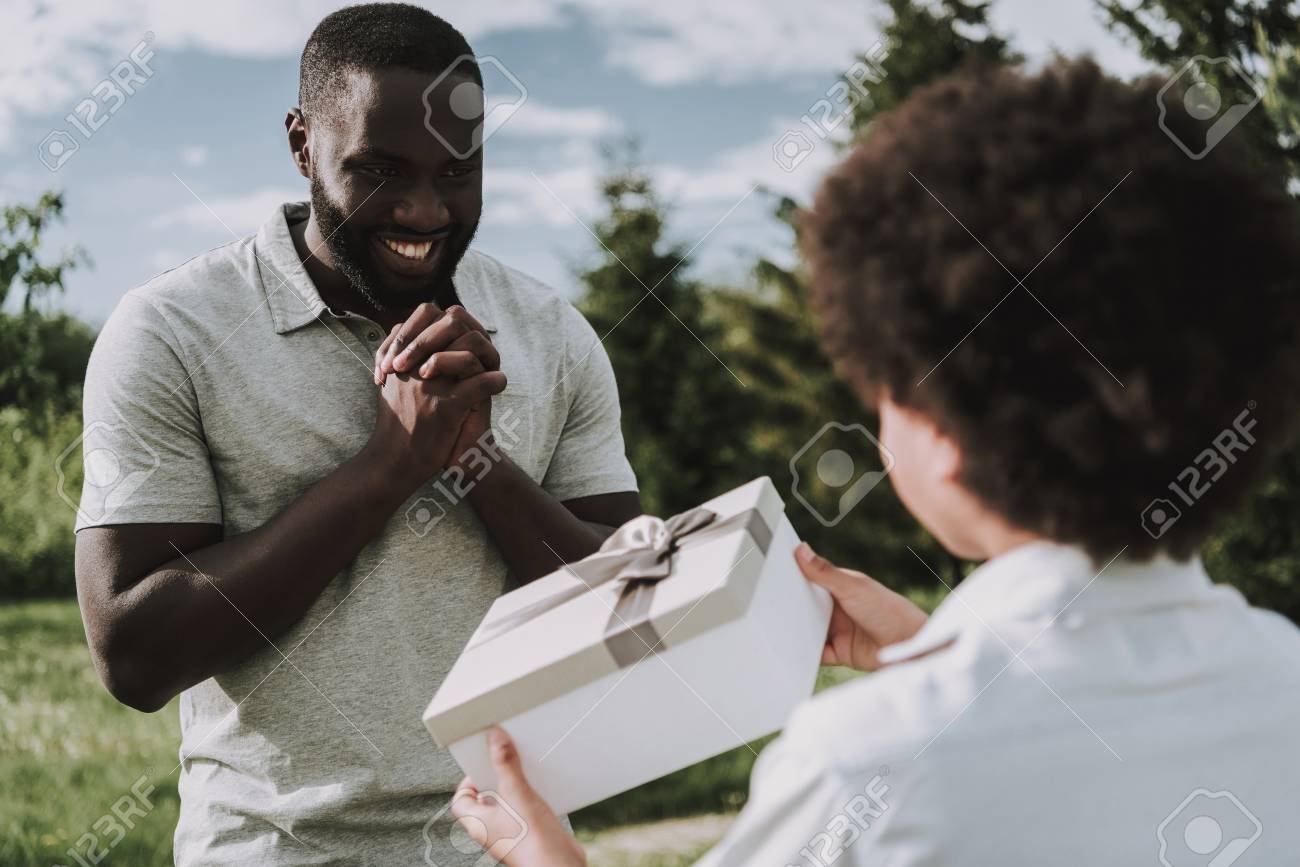 Son Gives Birthday Gift To Father Looks Happy Family Relations Celebration Concept