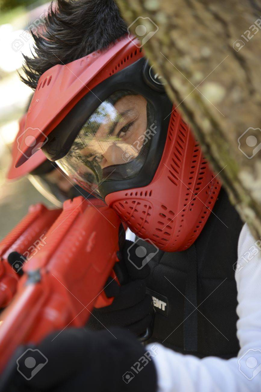 Young children playing paintball in the woods Stock Photo - 21933584