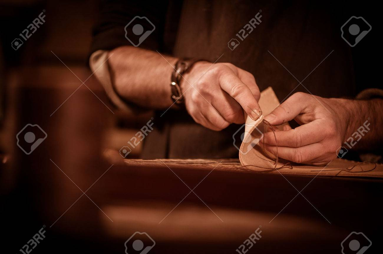 leather goods craftsman at work in his workshop, France Stock Photo - 56915510