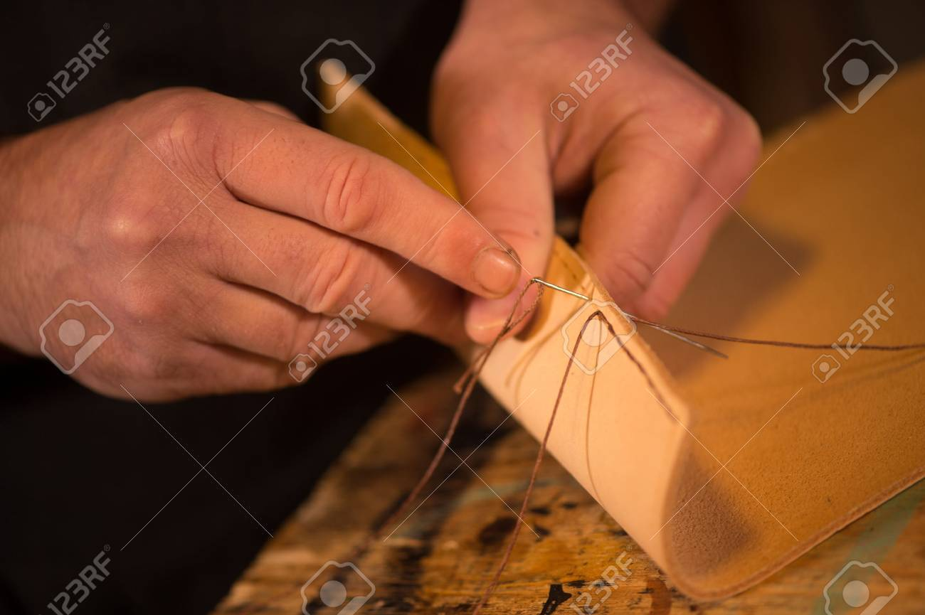 leather goods craftsman at work in his workshop, France Stock Photo - 56901422