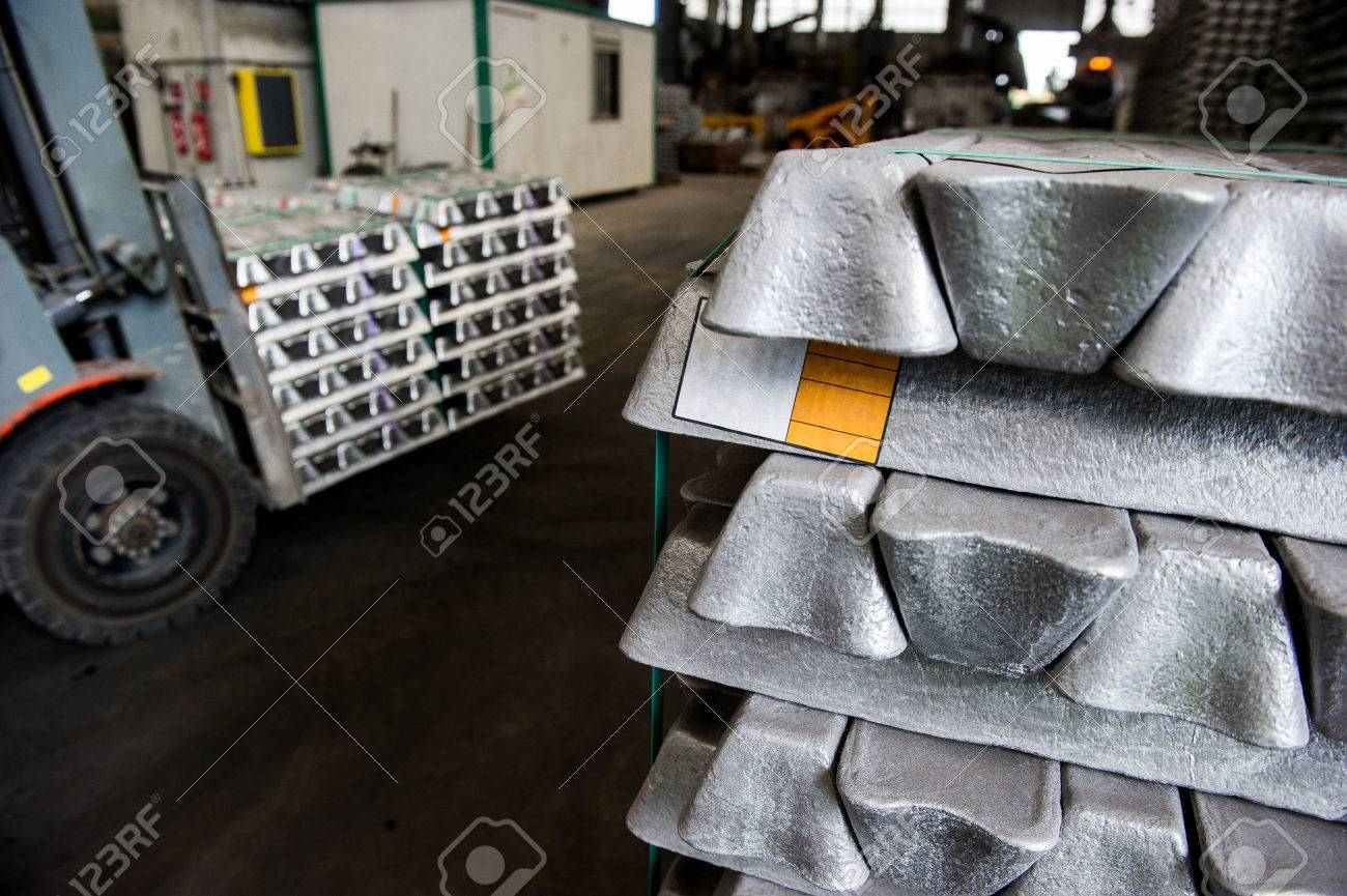 Stack of raw aluminum ingots in aluminum profiles factory, France Stock Photo - 71963255