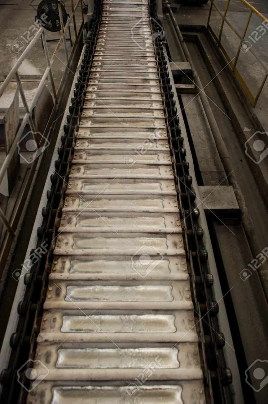 Stack of raw aluminum ingots in aluminum profiles factory, France Stock Photo - 71933297