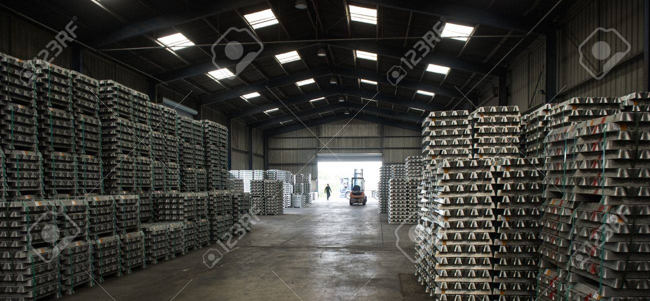 Stack of raw aluminum ingots in aluminum profiles factory, France Stock Photo - 72261295