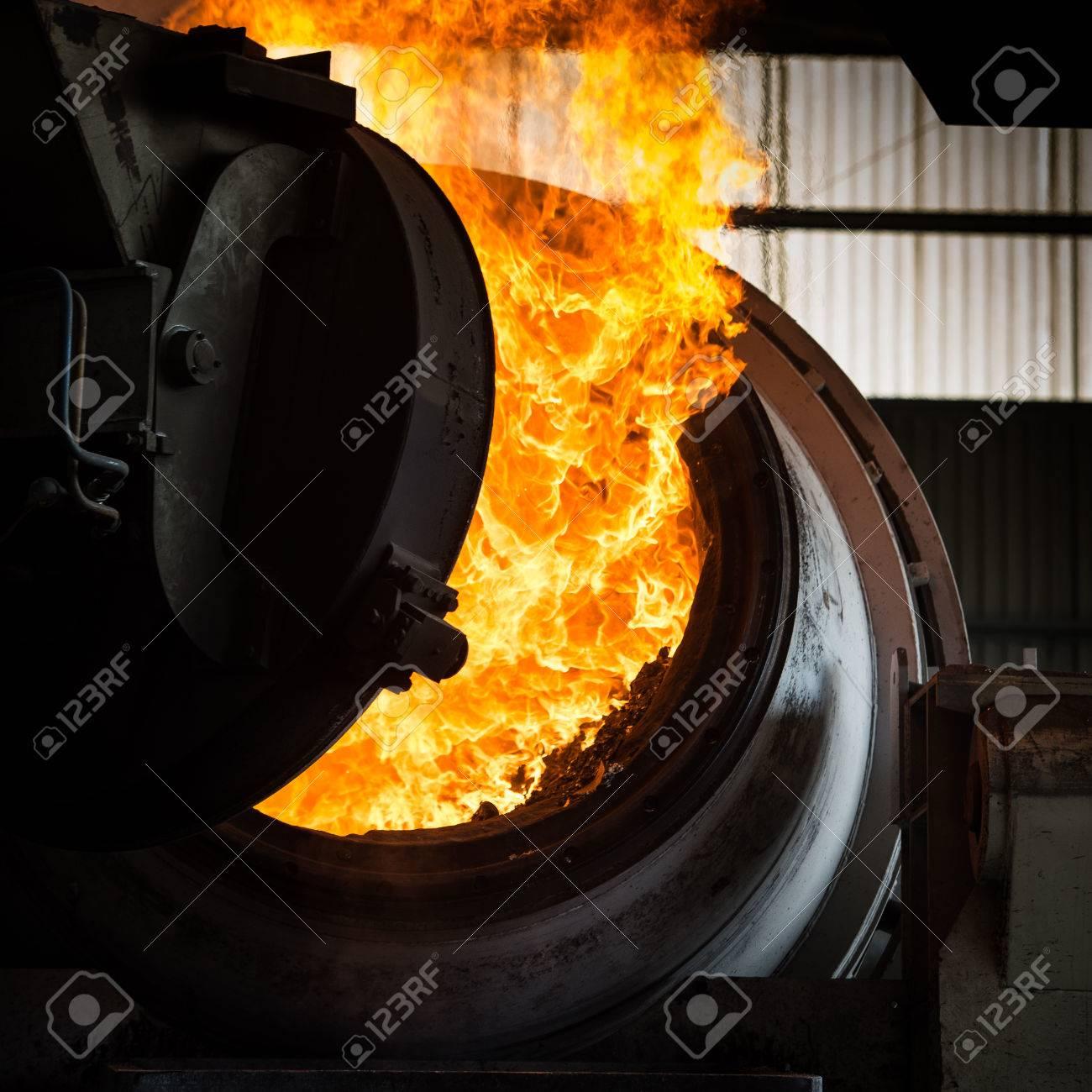 Hot steel pouring in steel plant, iron, aluminium Stock Photo - 71931479