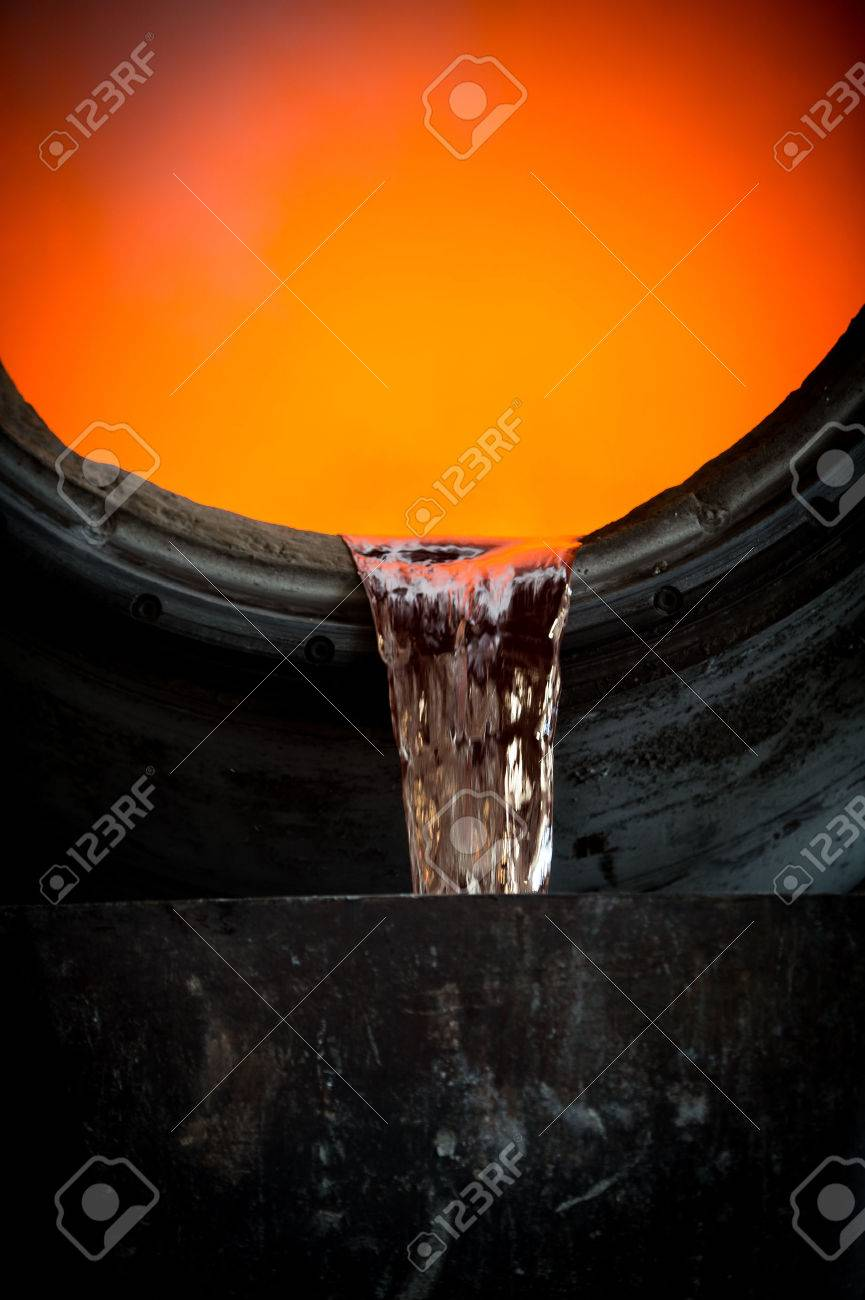 Hot steel pouring in steel plant, iron, aluminium Stock Photo - 72294017