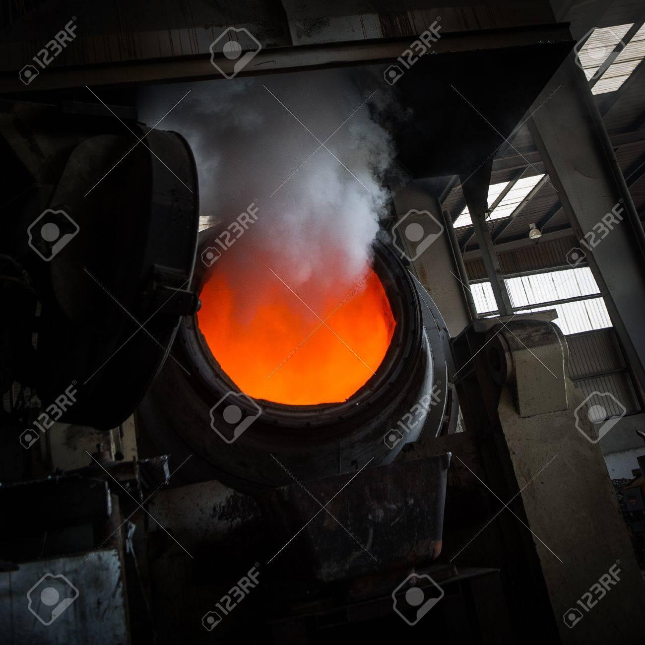 Hot steel pouring in steel plant, iron, aluminium Stock Photo - 71932403