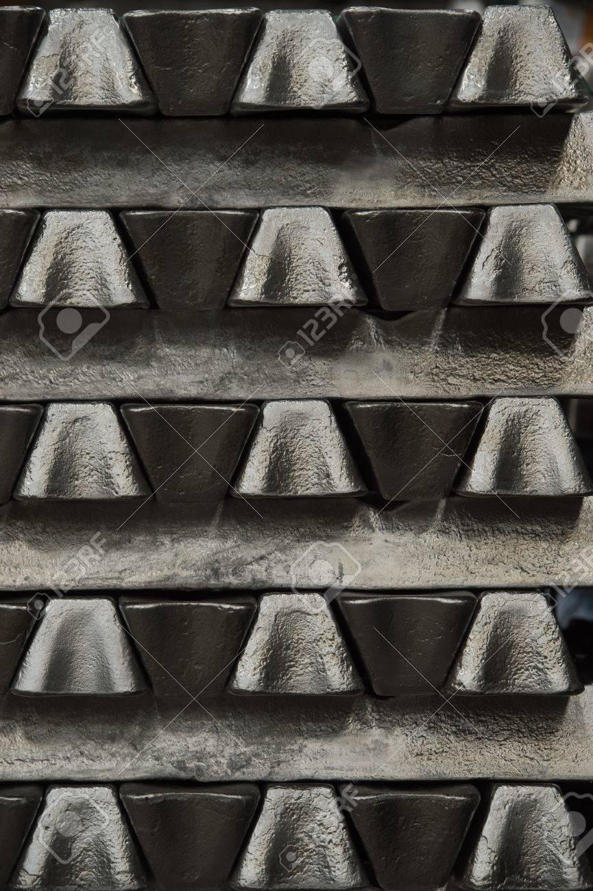 Stack of raw aluminum ingots in aluminum profiles factory, France Stock Photo - 71932081