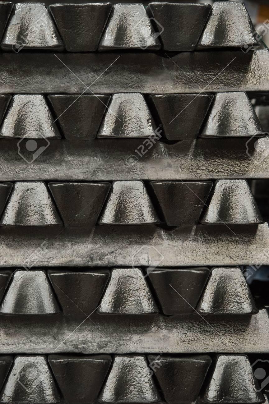 Stack of raw aluminum ingots in aluminum profiles factory, France Stock Photo - 71931818