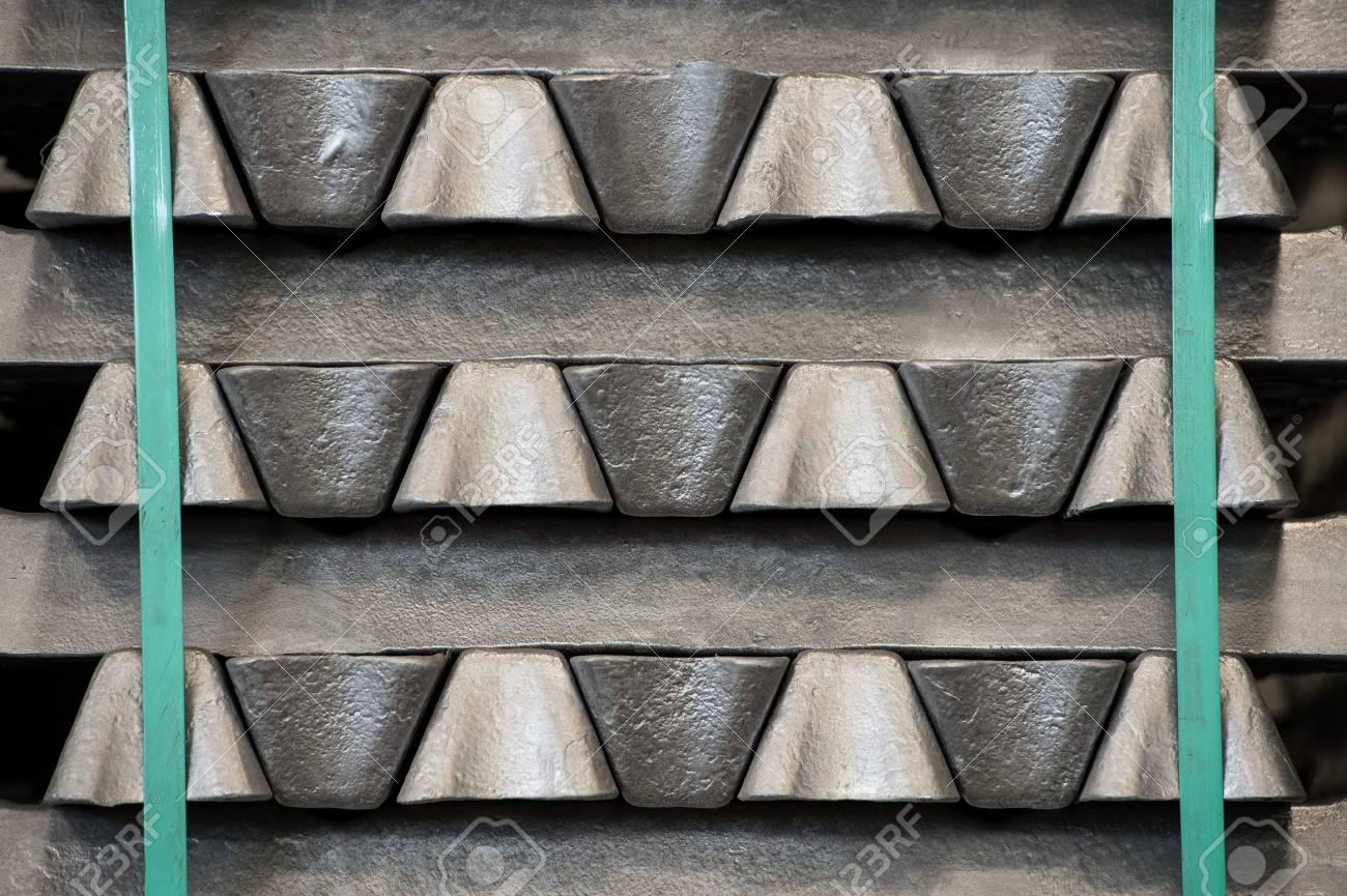 Stack of raw aluminum ingots in aluminum profiles factory, France Stock Photo - 71962500