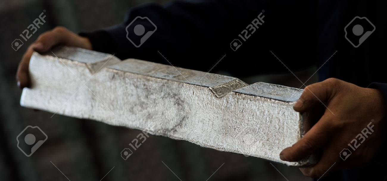 Stack of raw aluminum ingots in aluminum profiles factory, France Stock Photo - 71932498