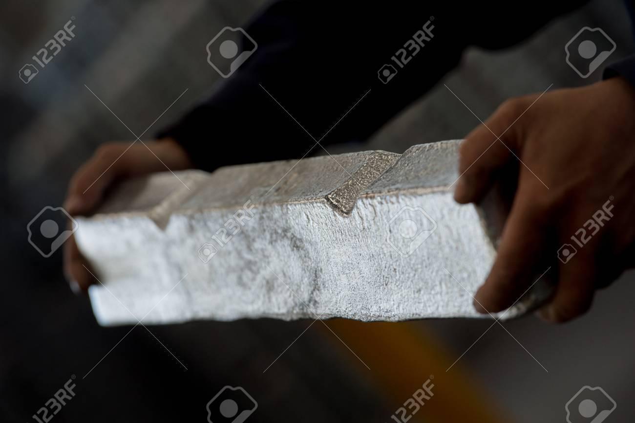 Stack of raw aluminum ingots in aluminum profiles factory, France Stock Photo - 71962726