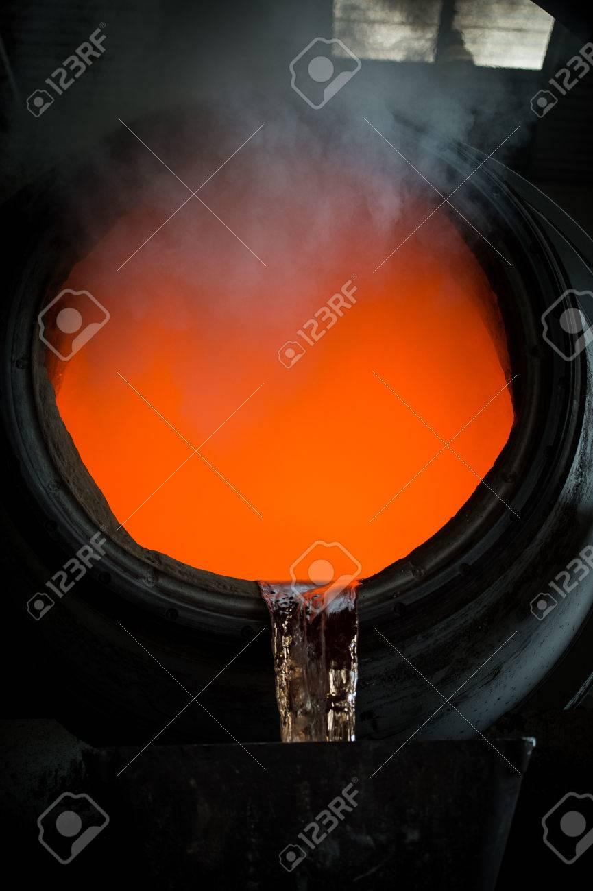 Hot steel pouring in steel plant, iron, aluminium Stock Photo - 71917051