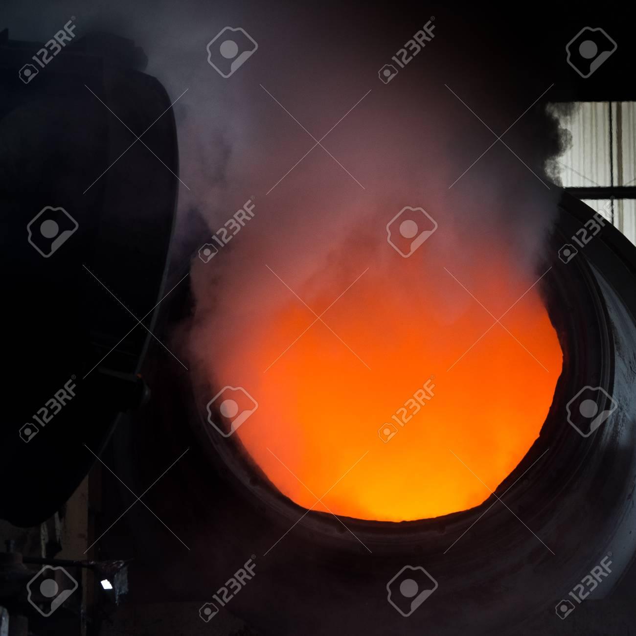 Hot steel pouring in steel plant, iron, aluminium Stock Photo - 71942952