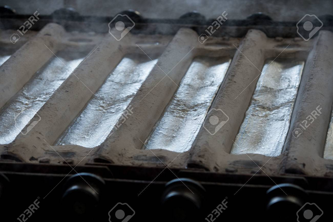 Stack of raw aluminum ingots in aluminum profiles factory, France Stock Photo - 71963137