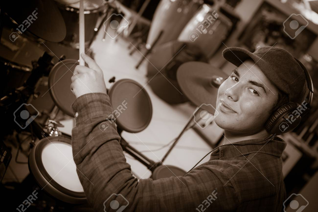 Stock Photo - Young blond caucasian boy plays drums in shop 98a1ddf576b0