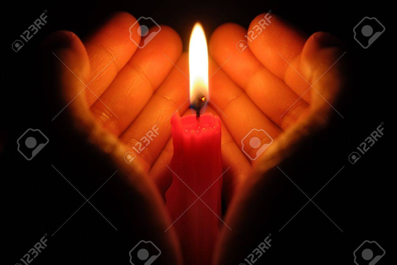 Hands Holding A Burning Candle In Dark Stock Photo, Picture And ... for Holding Candle In The Dark  83fiz