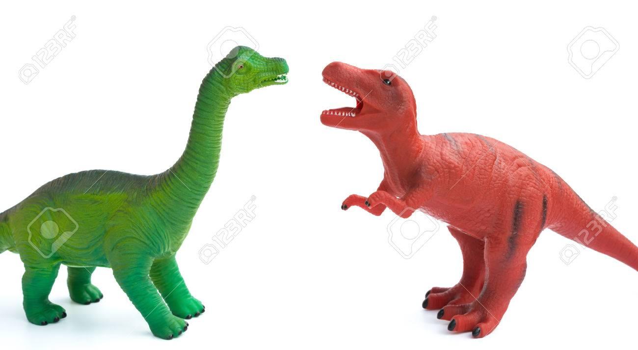 緑のブラキオサウルスと白地に赤ティラノサウルスのおもちゃ の写真素材