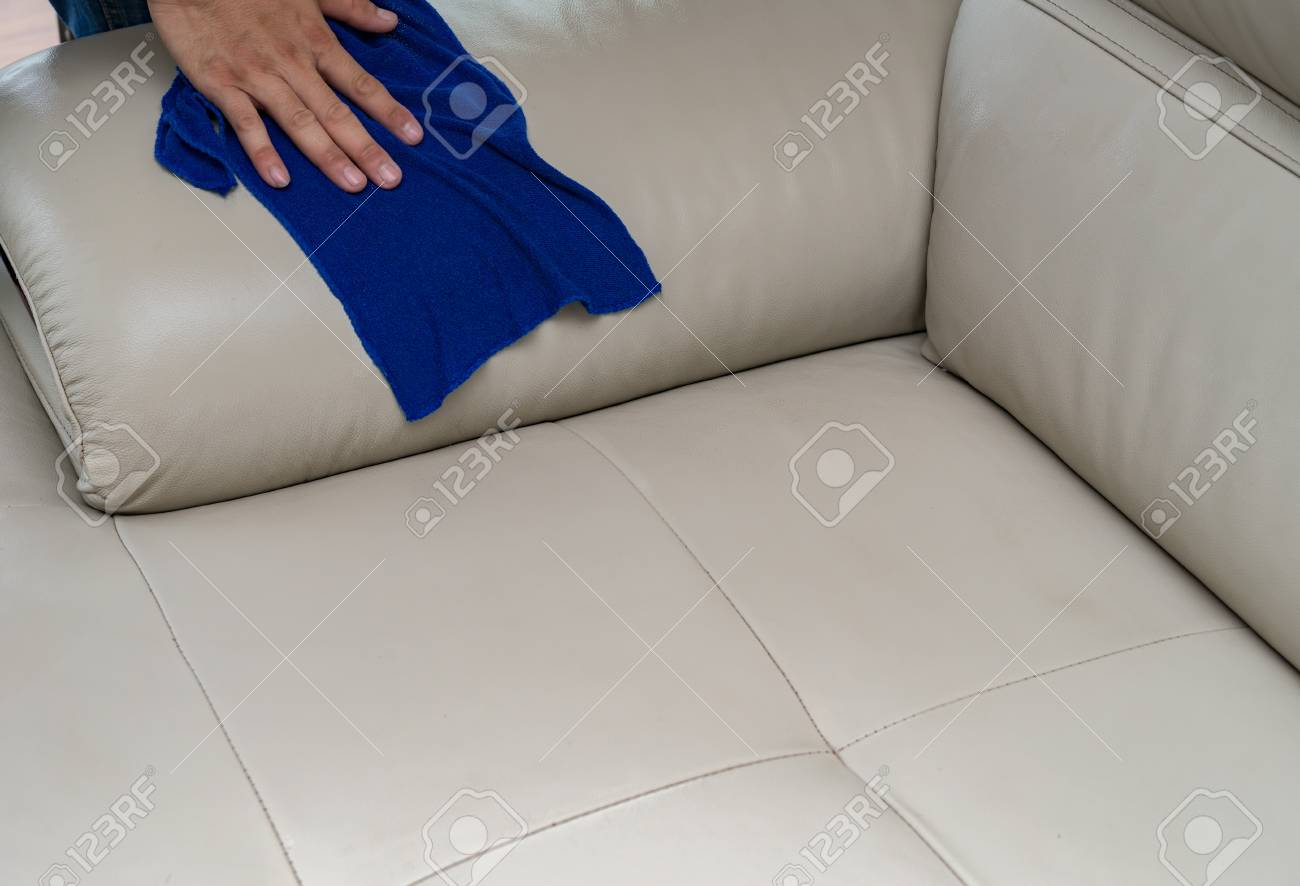 - Cleaning Leather Sofa With Towel At Home Stock Photo, Picture And