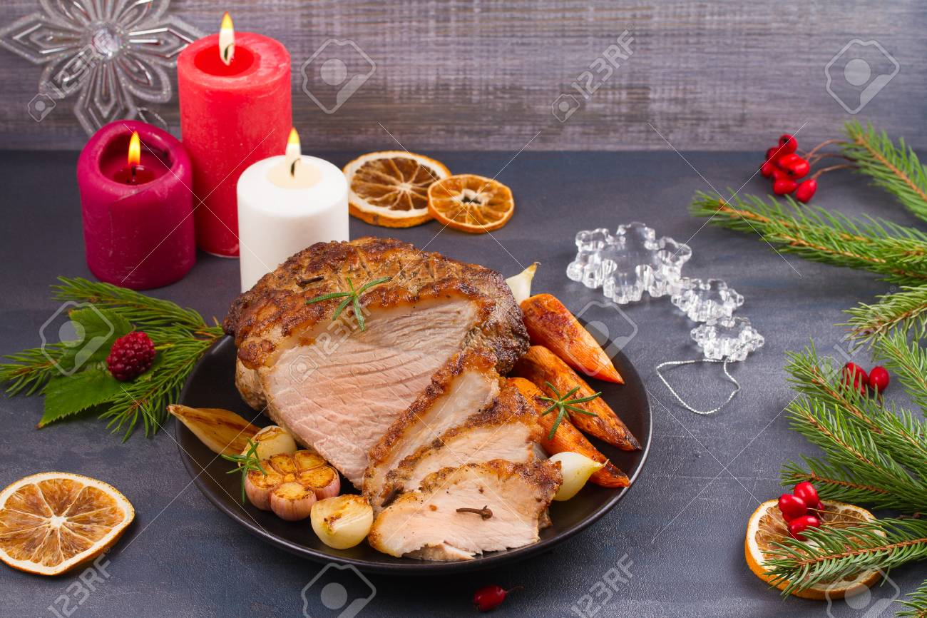 Christmas Ham Dinner.Roasted Christmas Ham On Black Plate And Festive Decoration