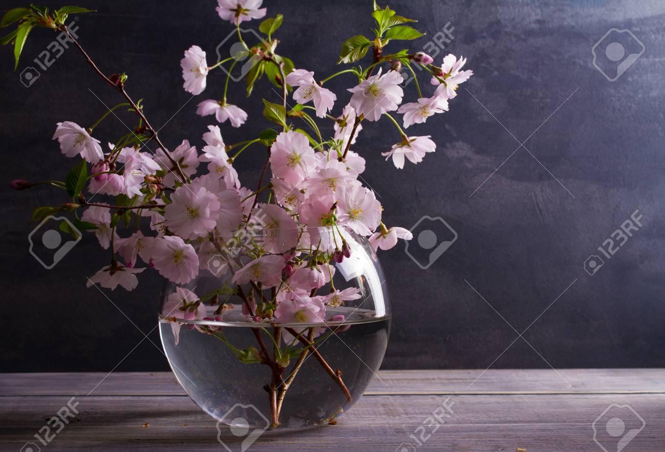 Spring Bouquet In Glass Vase On Vintage Wooden Background. Pink ...