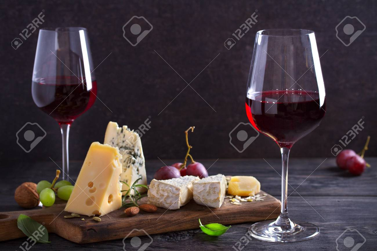 Red wine with cheese on chopping board. Wine and food concept - Image - 123168028