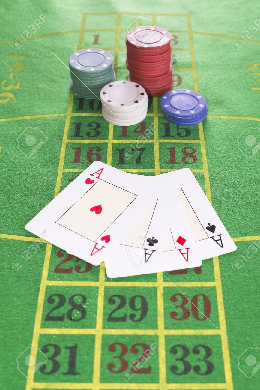 Four aces and poker rooms on green carpet with numbers drawn