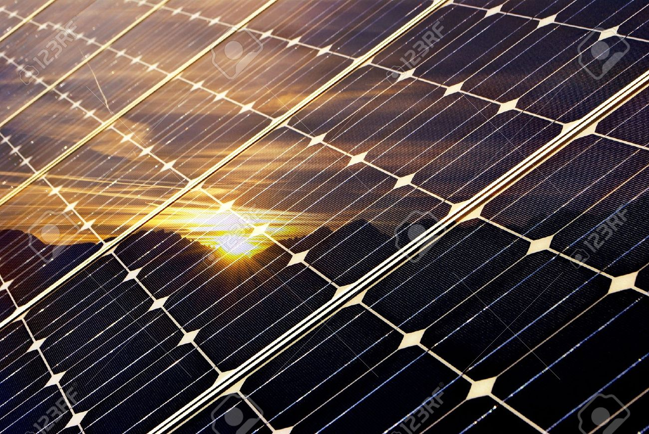solar panel with mountains and setting sun, green economy Stock Photo - 8955189