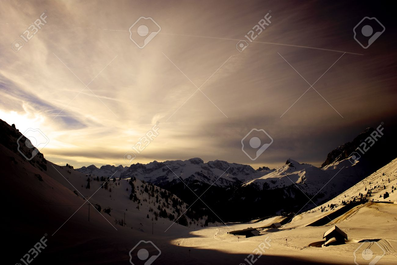 winter landscape with snow capped mountains and blue sky Stock Photo - 9478103
