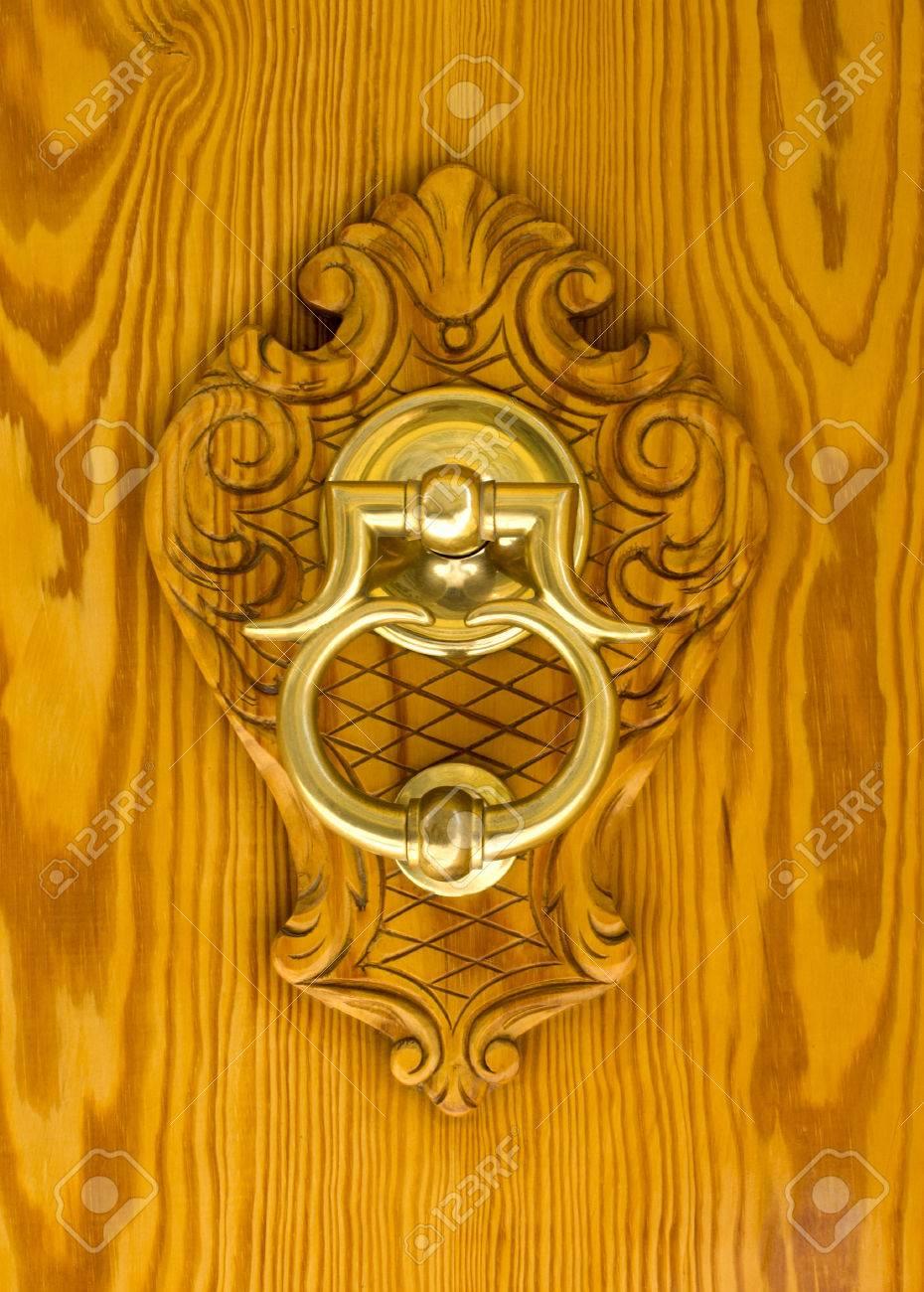 Modern Spanish Brass Door Knocker Mounted On Carving Set On A