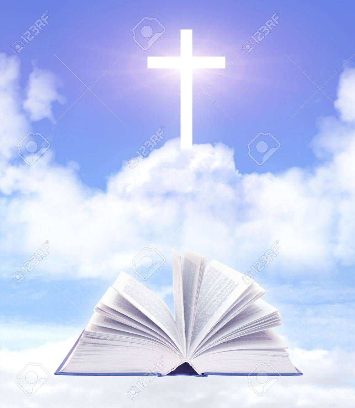 Bible and cross on cloud - 7933728
