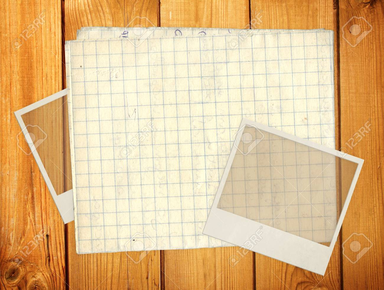 Old photos and paper for scrapbooking. Object over wooden plank Stock Photo - 16720417