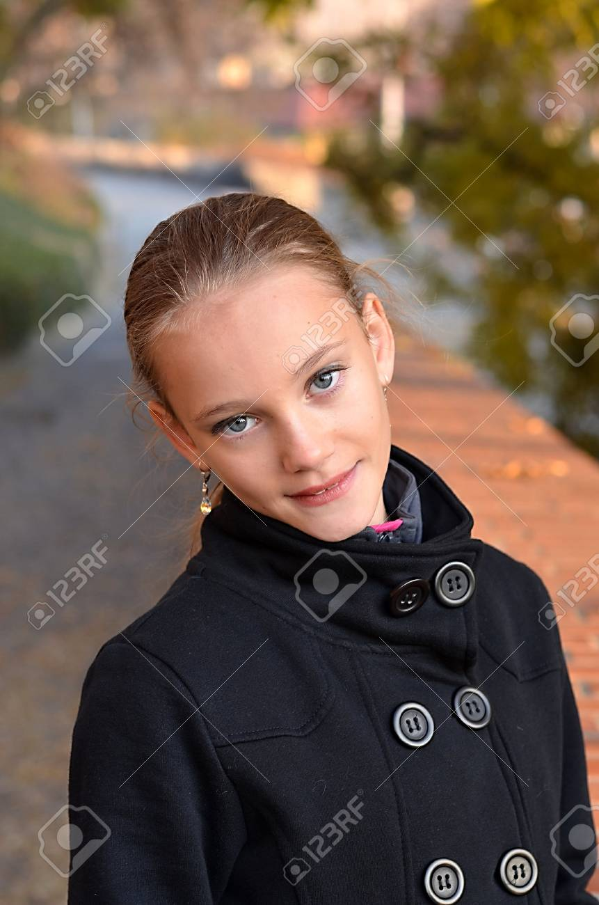 A Young Girl Smiles At You Stock Photo Picture And Royalty Free Image Image 12408634