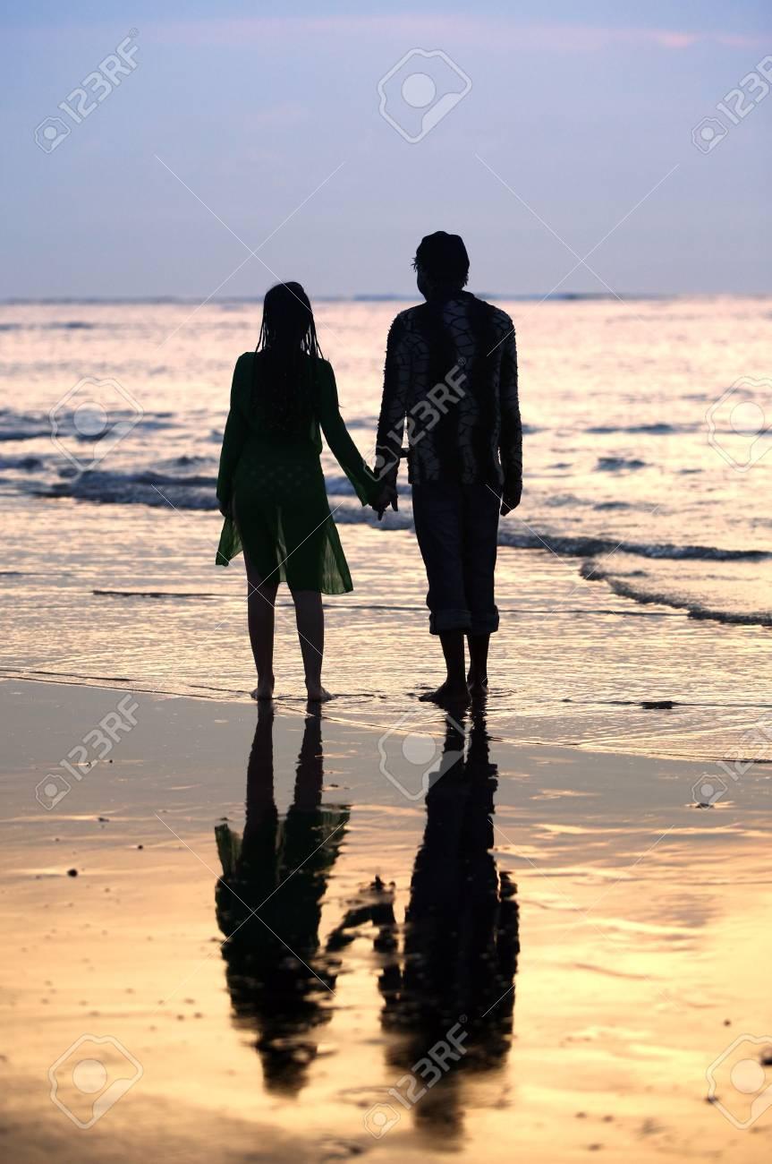 Couple on sunset. Coast of the Indian ocean Stock Photo - 2096836