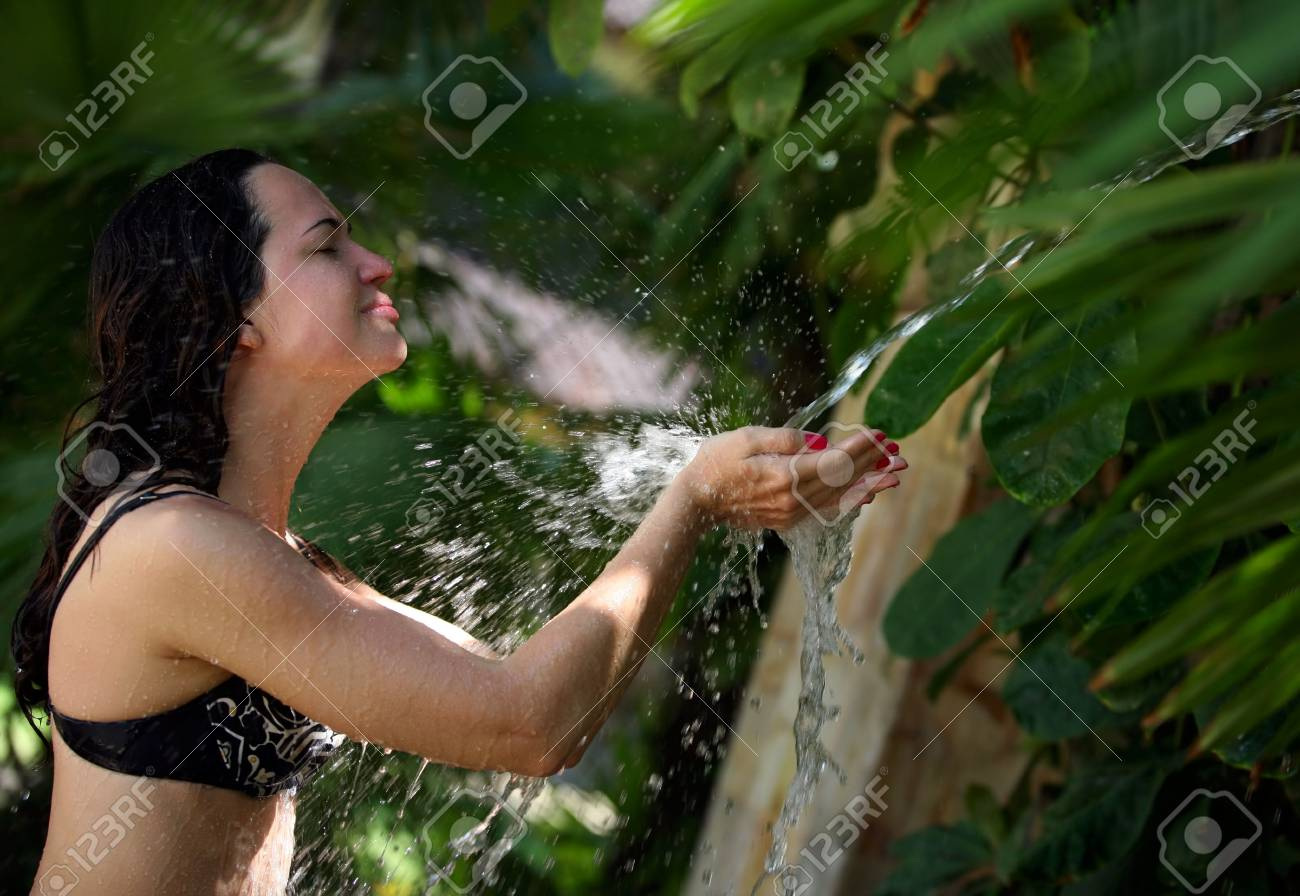 Beautiful woman standing in front of a waterfall Stock Photo - 2683837