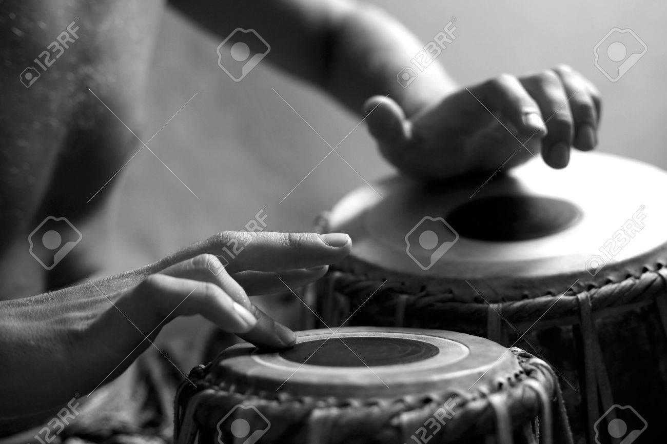 Man playing the djembe (nigerian drum) in studio Stock Photo - 2812682