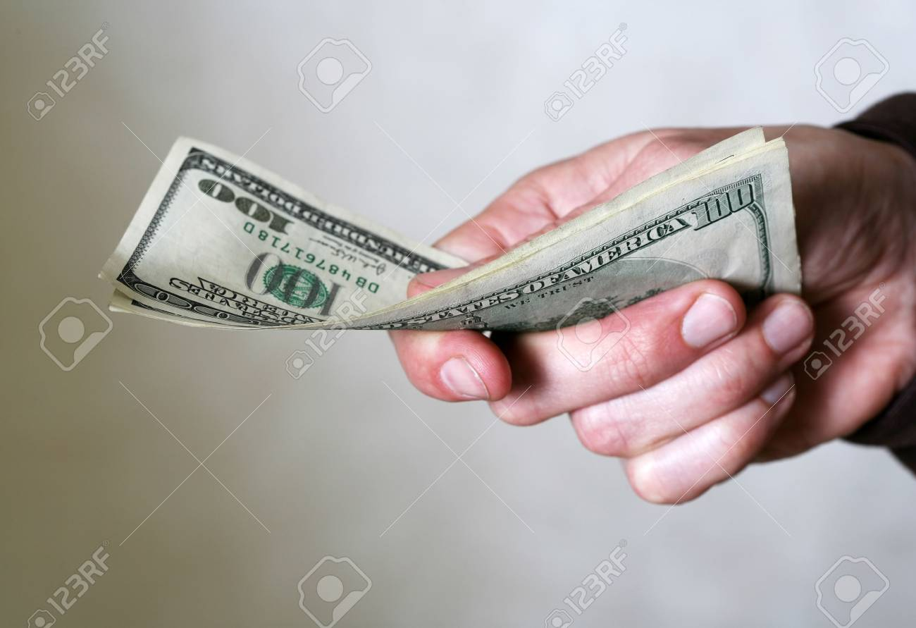 Hand of the Person with dollars Stock Photo - 3409893