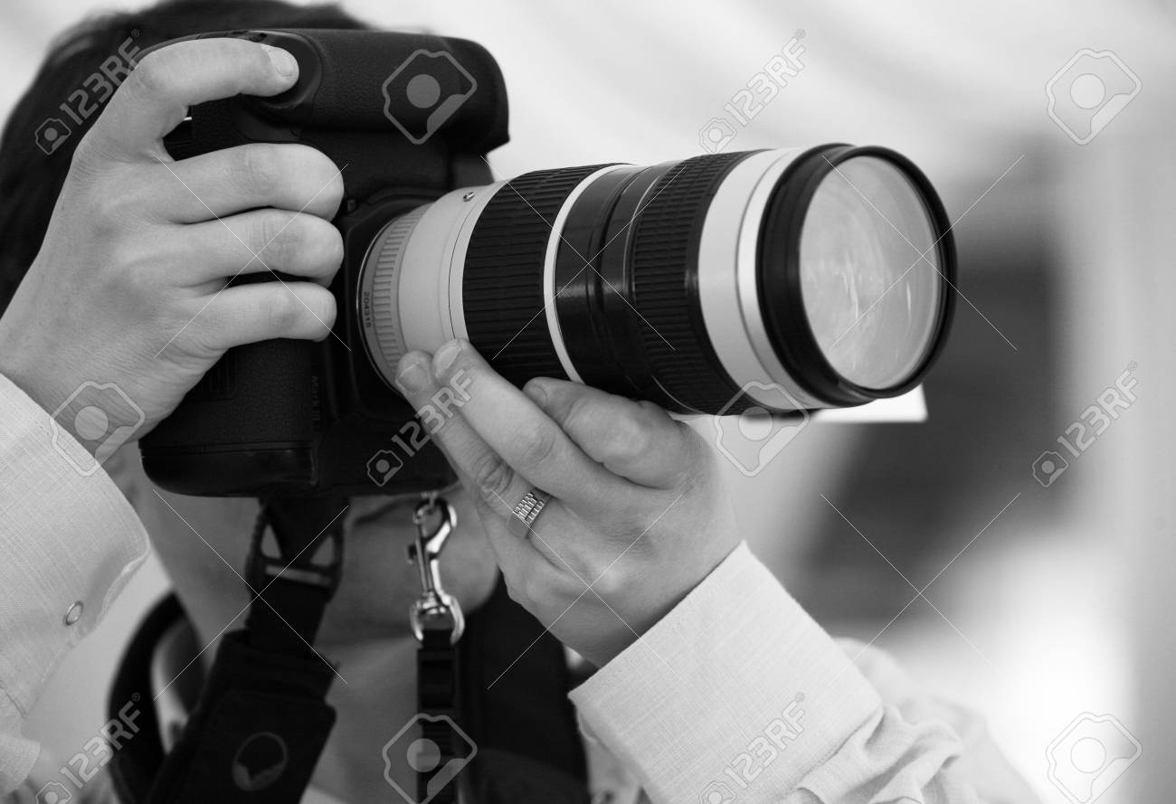 The photographer with the cameras makes the work Stock Photo - 3514968