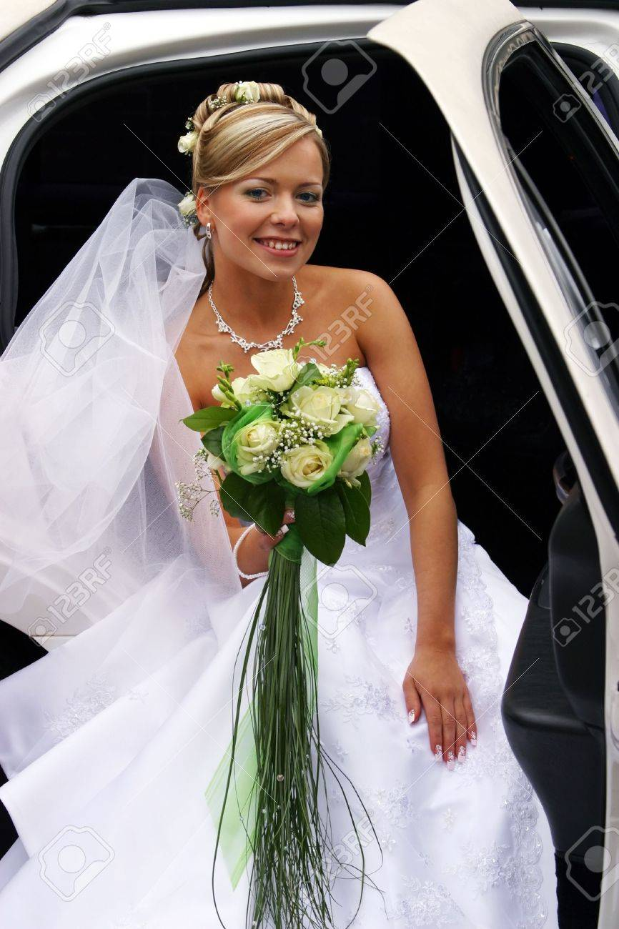 The beautiful bride with a bouquet in the automobile Stock Photo - 3644823