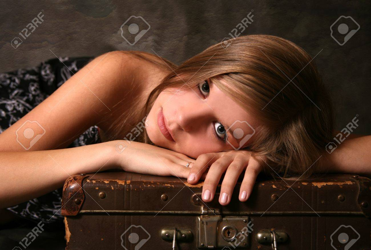 Sad girl with old suitcase in studio Stock Photo - 4136140