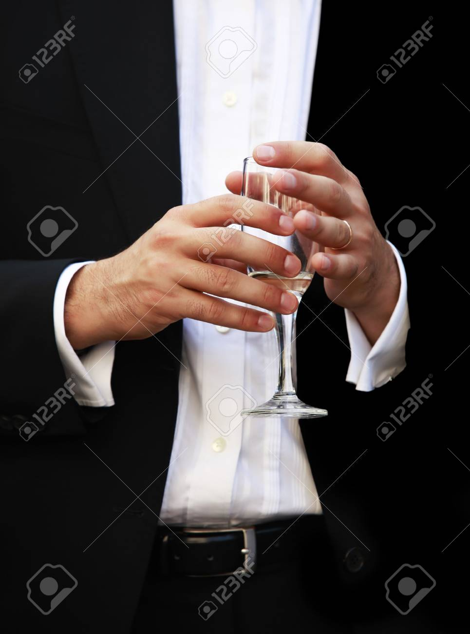 Glass of champagne in a hand of the groom Stock Photo - 5331077