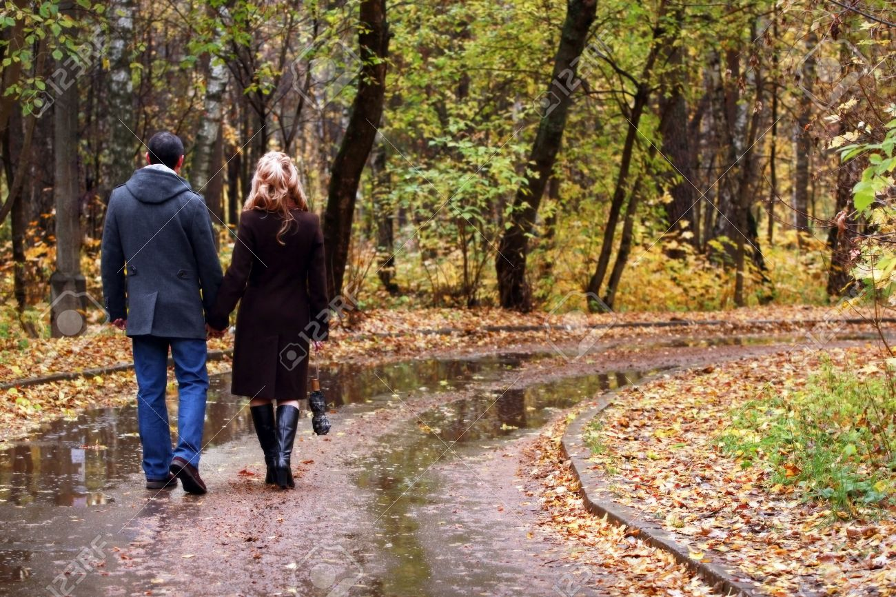 The in love pair in autumn park Stock Photo - 10908260